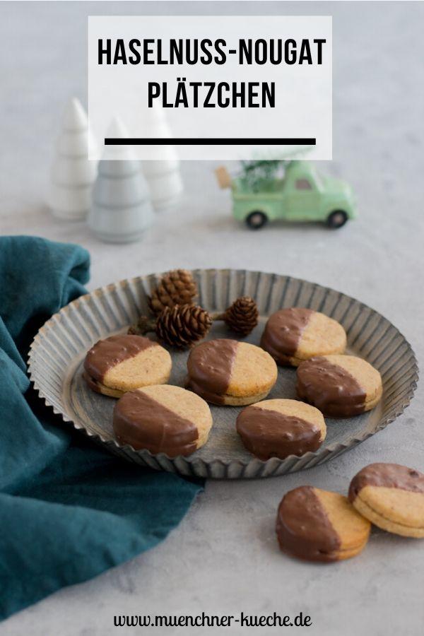 Feine Haselnuss-Nougat-Plätzchen. Die gefüllten Kekse schmecken einfach zu gut. | www.muenchner-kueche.de #kekse #plätzchen #nougat #kuvertüre #weihnachten #münchnerküche